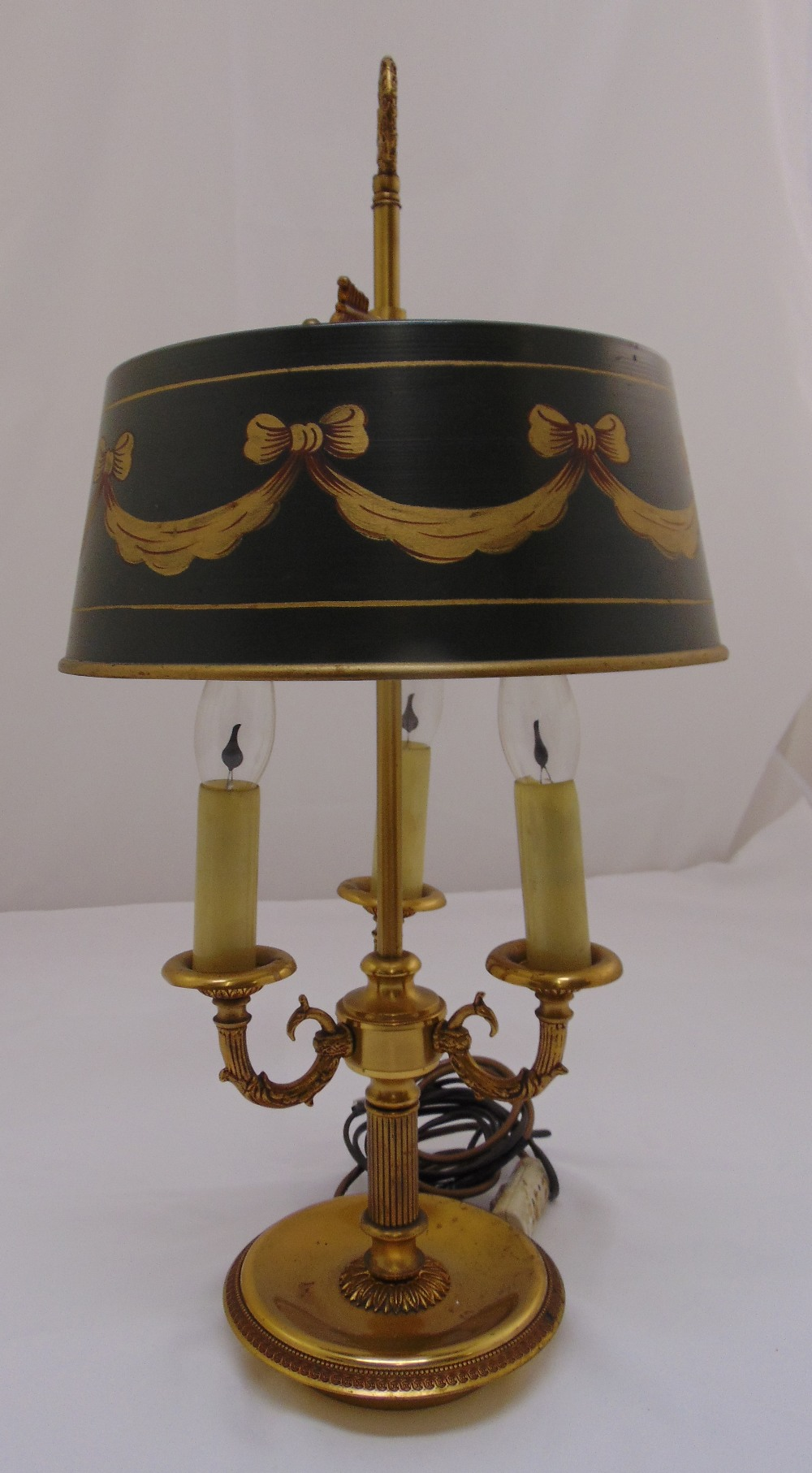 Lot 34 - A three branch lamp stand with painted metal shade on raised circular base, 60cm (h)