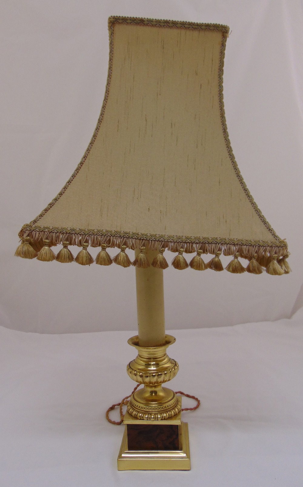 Lot 35 - A gilded metal and onyx lamp stand on square plinth to include shade , 74cm (h)