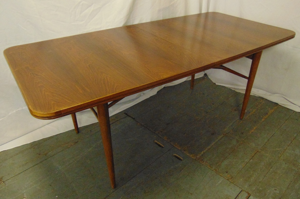 Lot 2 - Archie Shine rectangular dining table designed by Robert Heritage with two drop in leaves on four