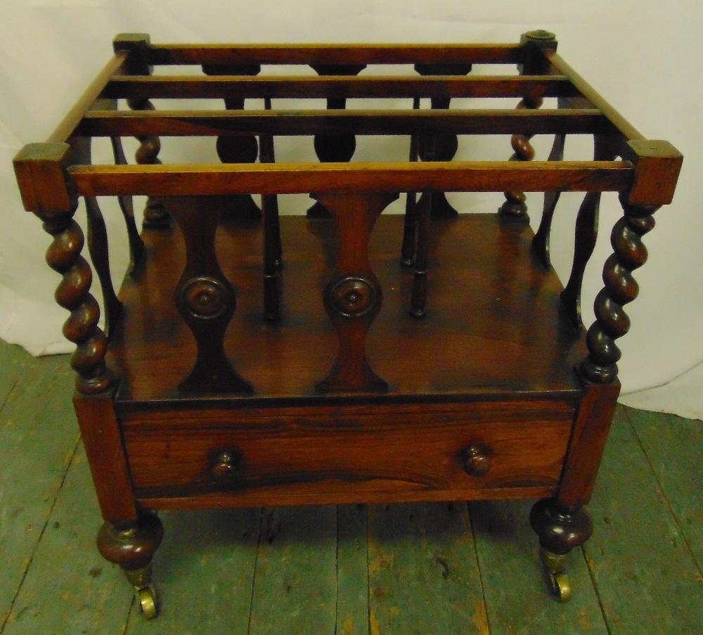 Lot 15 - Mahogany three section Canterbury with a single drawer on original castors, 54 x 50.5 x 38cm