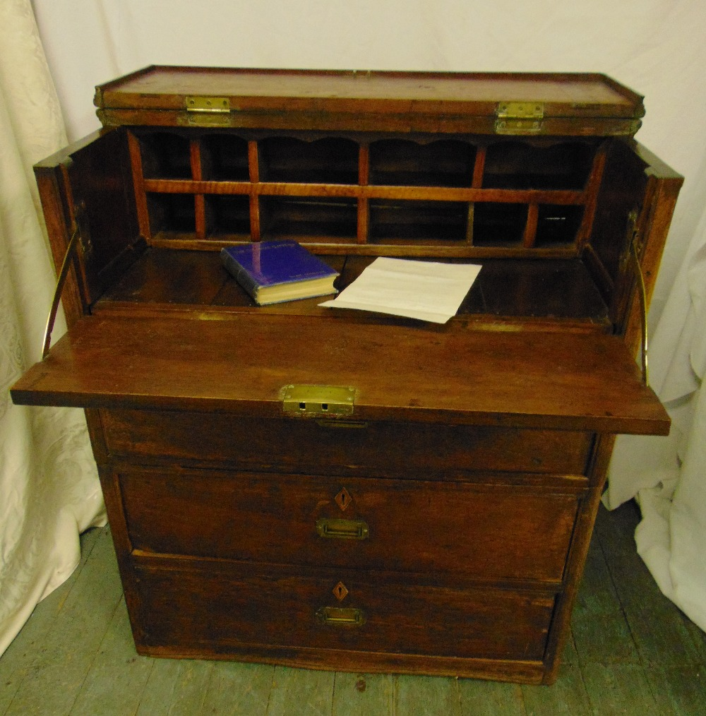 Lot 10 - A Colonial Clipper rectangular oak sea chest with three drawers and hinged top section revealing a