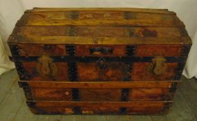 A late 19th century rectangular steamer trunk with metal and wooden bands and domed hinged cover, 55
