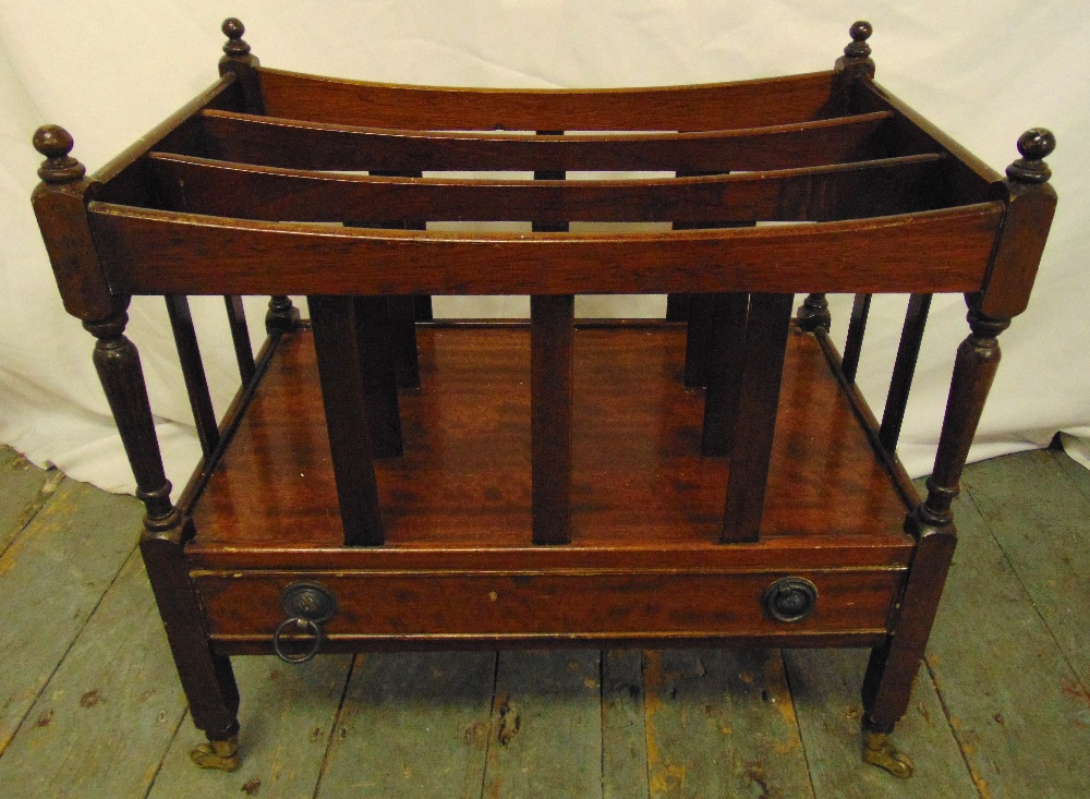 Lot 26 - A mahogany rectangular Canterbury with a single drawer, ball finials on original brass castors, 53 x
