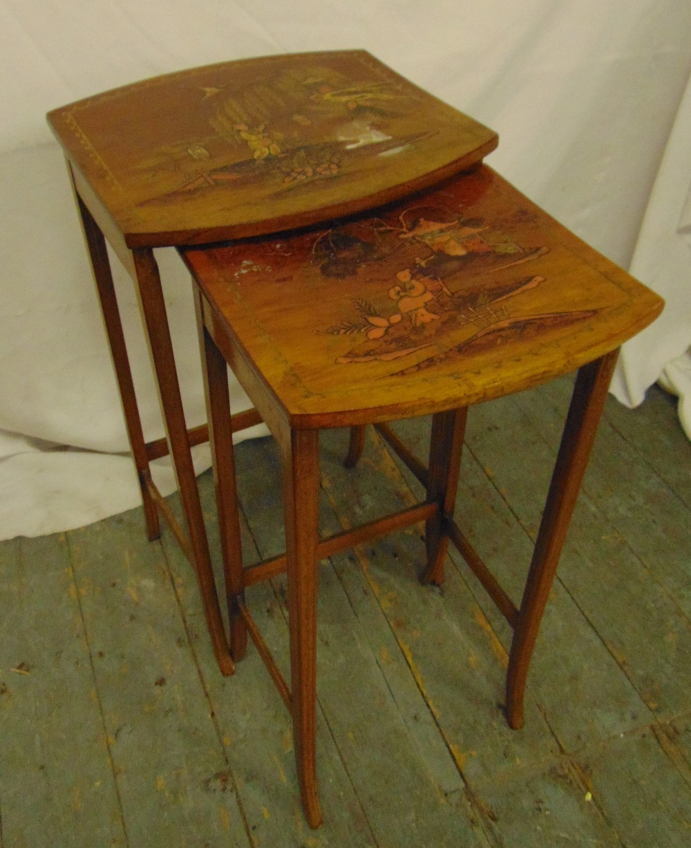 Lot 24 - A nest of two fruitwood side tables, the tops painted with Chinoiserie scenes, 67.5 x 36.5 x 34.5cm