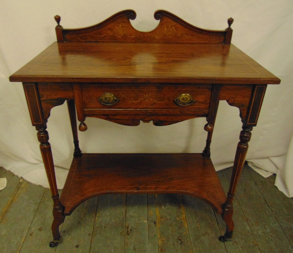 Lot 4 - An Edwardian rectangular mahogany hall table with swan neck pediment on four turned supports with