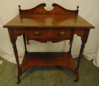 An Edwardian rectangular mahogany hall table with swan neck pediment on four turned supports with