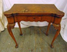 A late 19th century rectangular mahogany games table on four carved legs with hinged top and