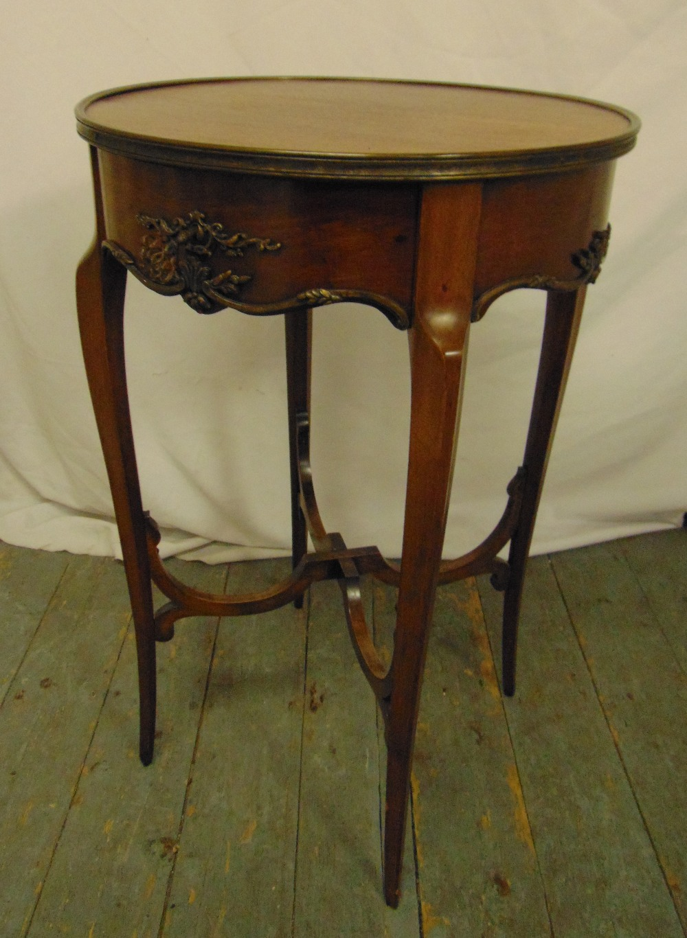 Lot 18 - A mahogany circular occasional table on four tapering sabre legs, 77 x 48.5cm