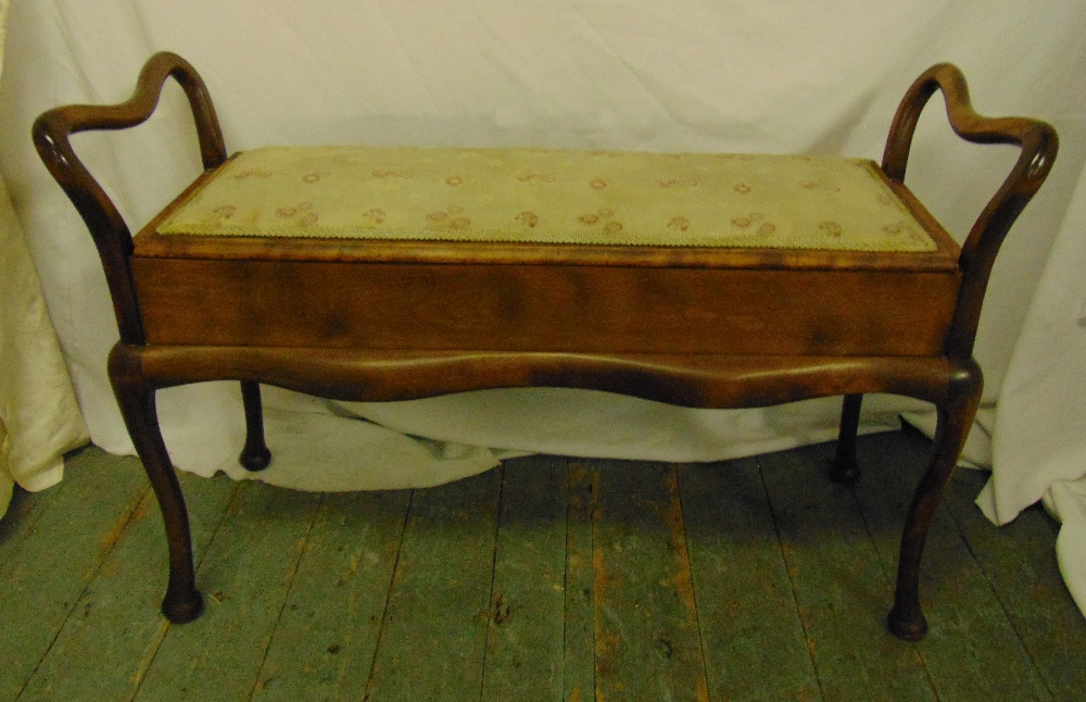 Lot 39 - A mahogany rectangular piano stool with upholstered hinged seat, scrolling sides and legs, 64.5 x 99