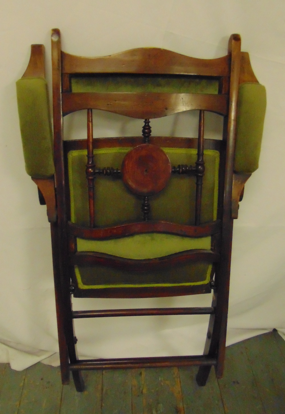 Lot 34 - A upholstered mahogany folding campaign chair, 93 x 57 x 63cm