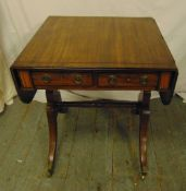 A rectangular mahogany drop flap sofa table with two drawers on cabriole legs, A/F, 73 x 104 x 58.