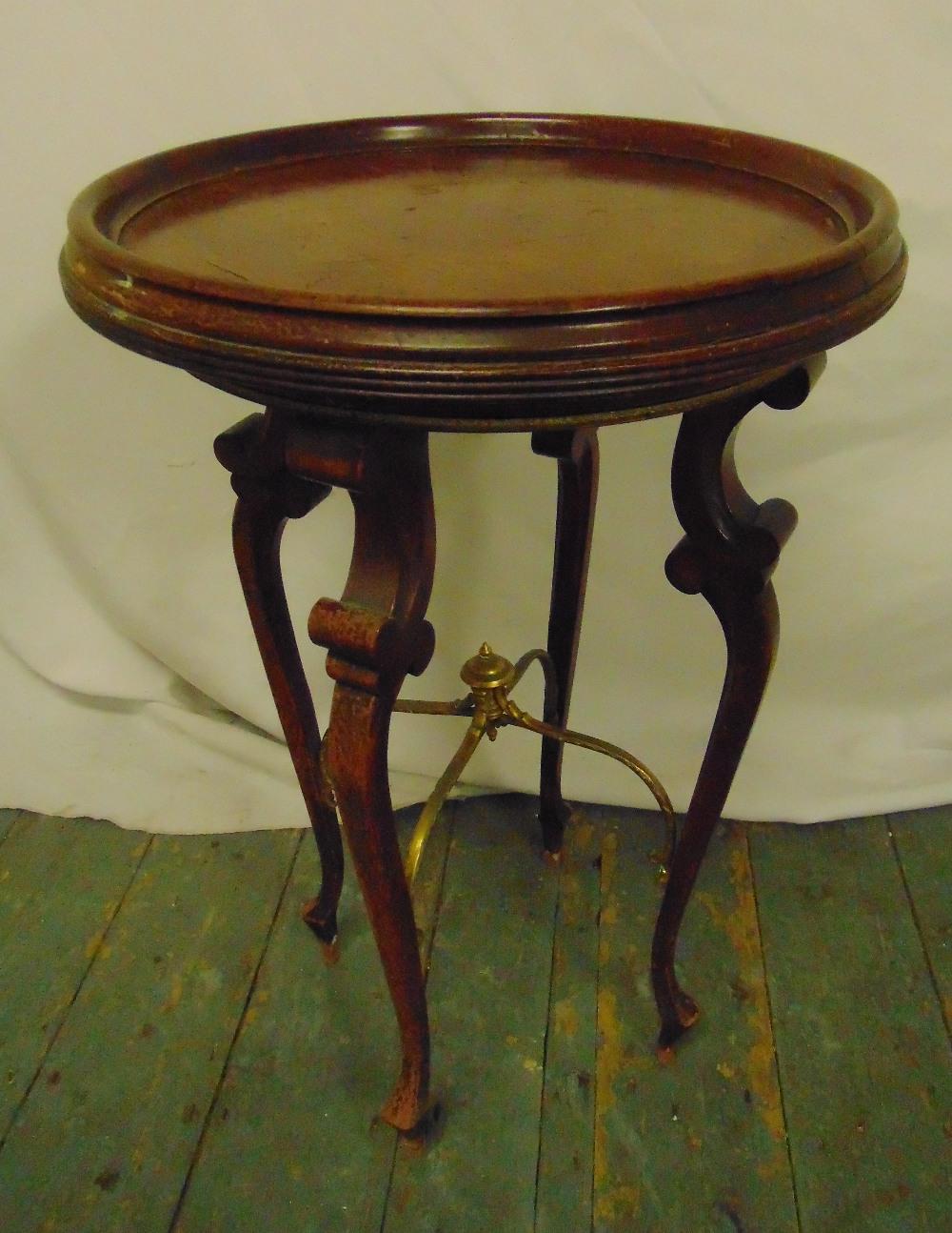 Lot 19 - A mahogany circular side table on four cabriole legs, 61 x 40cm