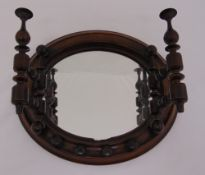 A Victorian turned mahogany wooden hall mirror with turned coat hooks, 31 x 36cm