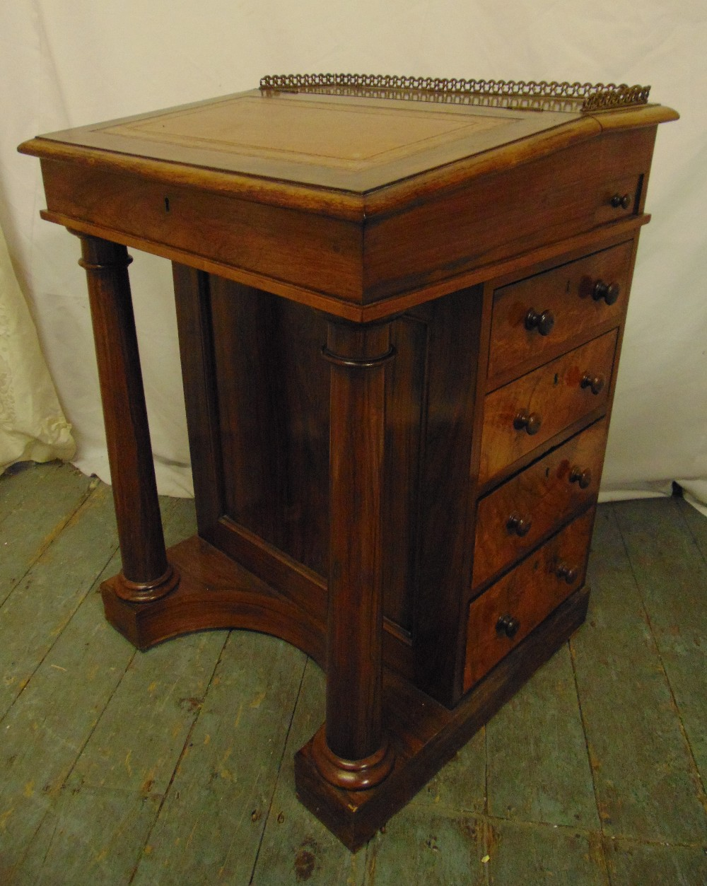 Lot 6 - A Victorian mahogany Davenport of customary form with tooled leather hinged top, five drawers on