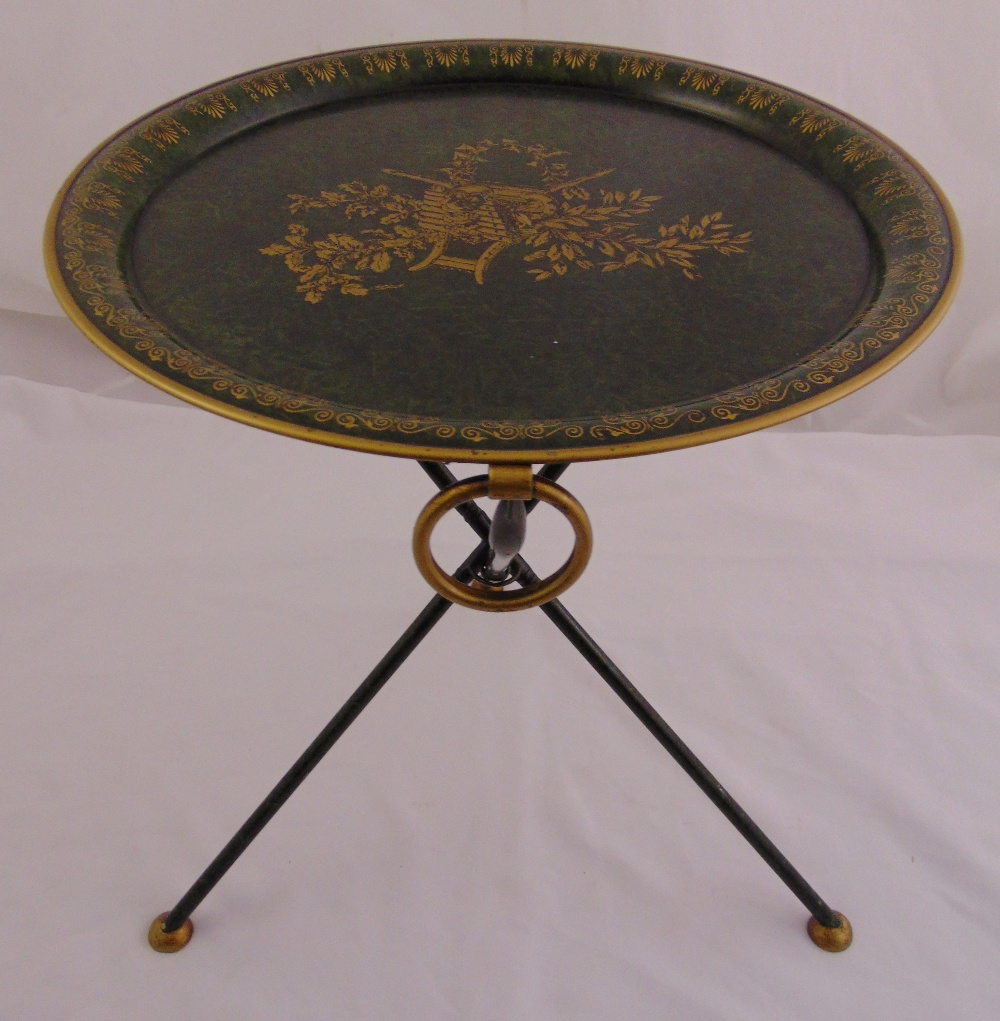 Lot 28 - An Italian Toleware folding table, circular with gilt decoration on three tubular supports, 48.5 x