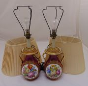 A pair of continental lamp bases, Viennese style, baluster form, decorated with floral sprays to