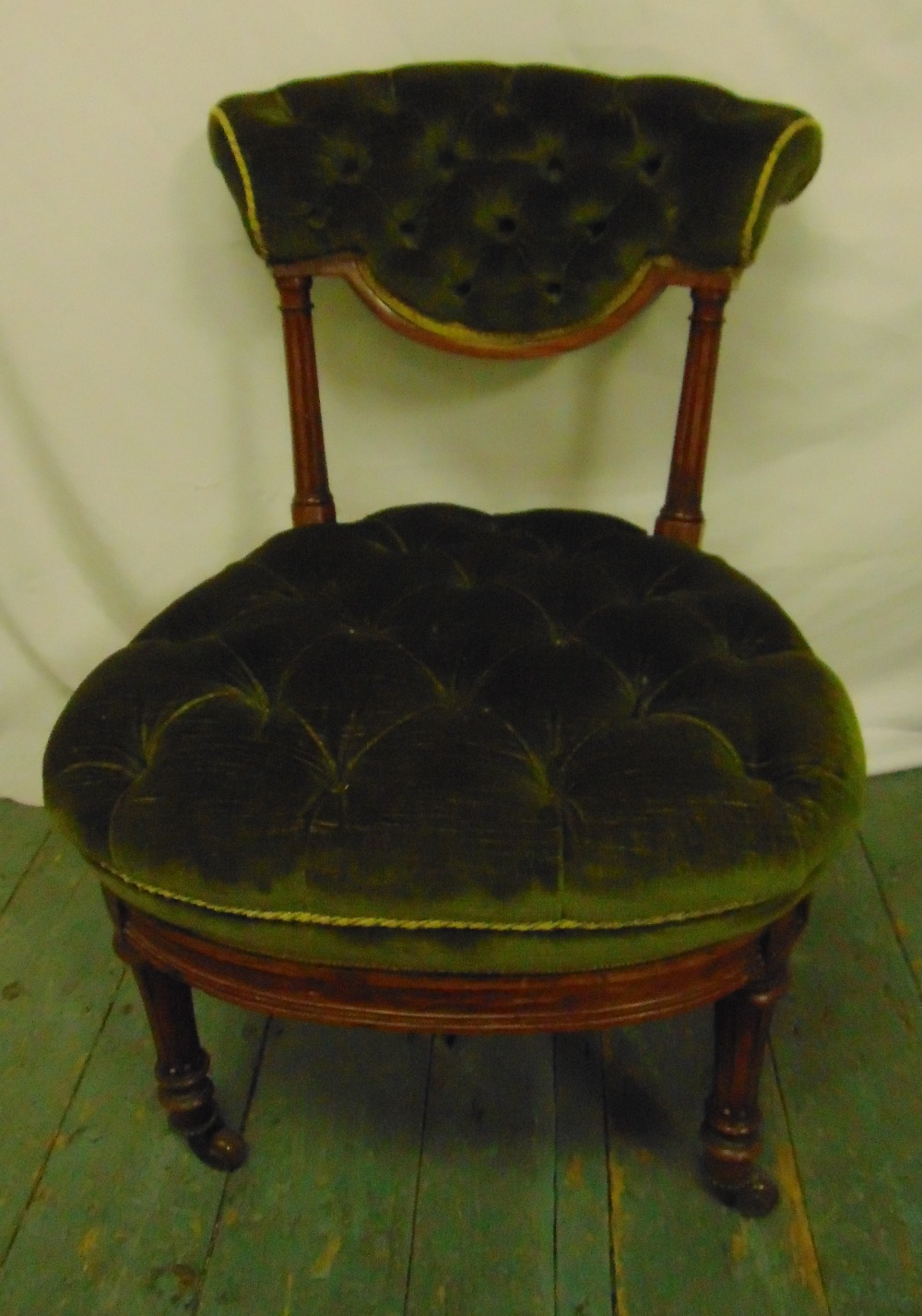 Lot 32 - A Victorian mahogany button back upholstered nursing chair on turned cylindrical legs, 67 x 48 x