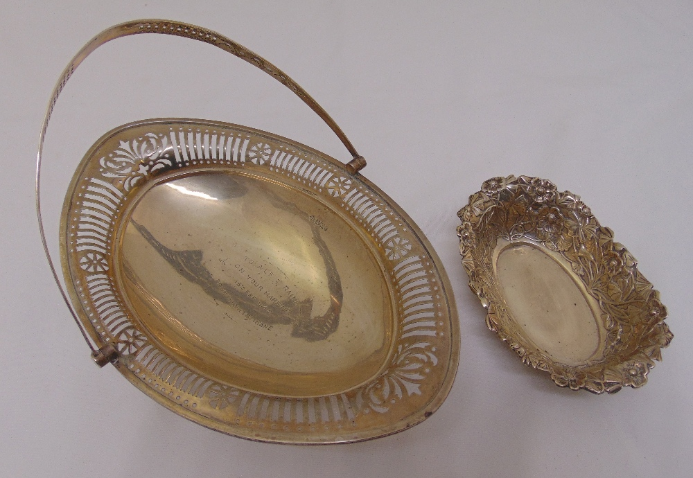 Lot 375 - An oval bar pierced silver fruit basket with pierced swing handle on raised oval bar pierced foot,