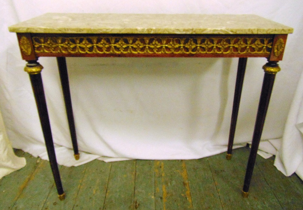 Lot 8 - A rectangular mahogany and marble consol table with fluted cylindrical legs and stylised floral