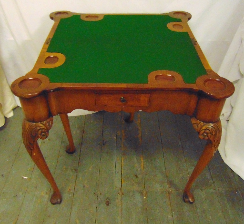 Lot 7 - A late 19th century rectangular mahogany games table on four carved legs with hinged top and
