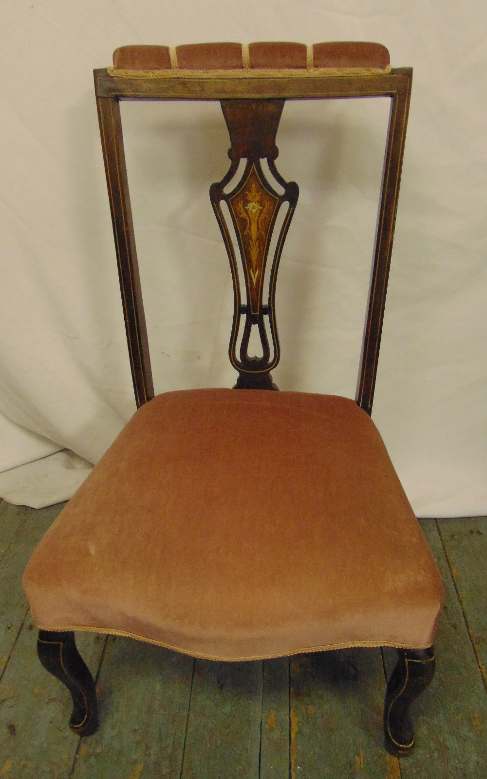 Lot 35 - An Edwardian upholstered nursing chair with satinwood stringing, on four scroll legs