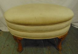 A mahogany oval upholstered bedroom stool on four carved bracket supports, 45 x 71 x 46cm