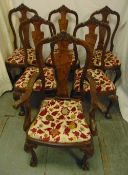 A set of six early 20th century mahogany and burr walnut dining chairs with upholstered seats and