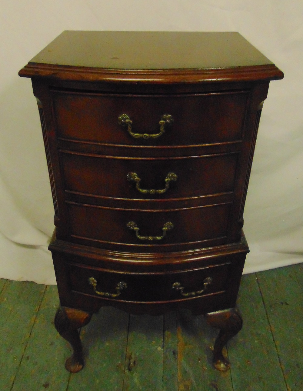Lot 11 - A rectangular mahogany chest of four drawers with swing handles on cabriole legs, 76 x 39 x 32cm