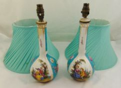 A pair of continental porcelain table lamps decorated with 18th century courtship scenes with silk