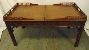 A Chinese style rectangular coffee table with pierced gallery and leather top opening to reveal a