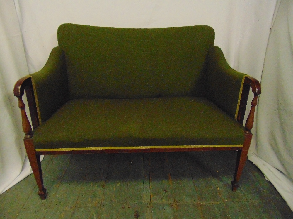 Lot 12 - An Edwardian two seater settle with upholstered seat and back on tapering rectangular legs