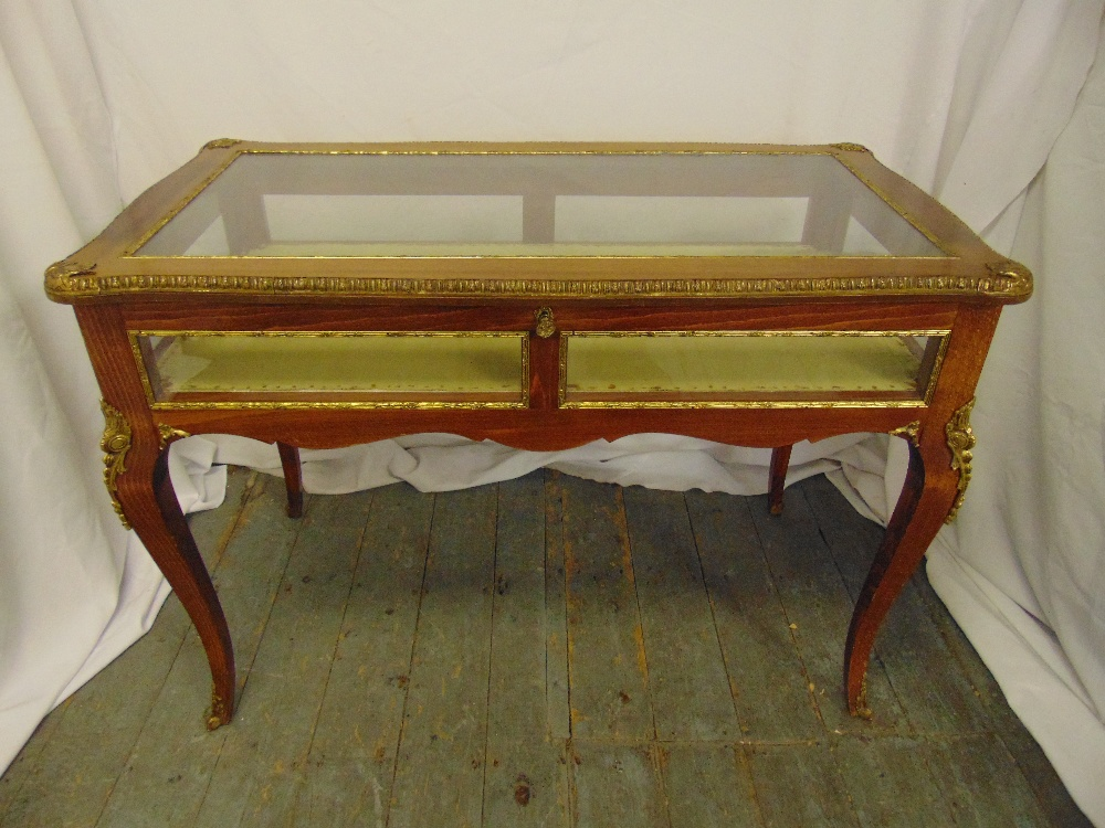 Lot 3 - A Louis XVI style rectangular mahogany and gilt metal bijouterie display table with glazed sides