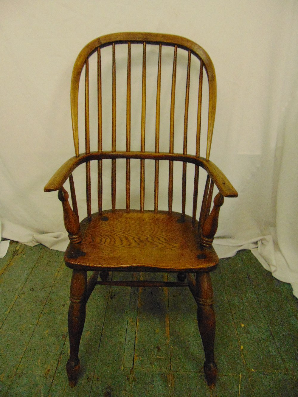 Lot 11 - A 19th century oak Windsor chair on turned cylindrical legs
