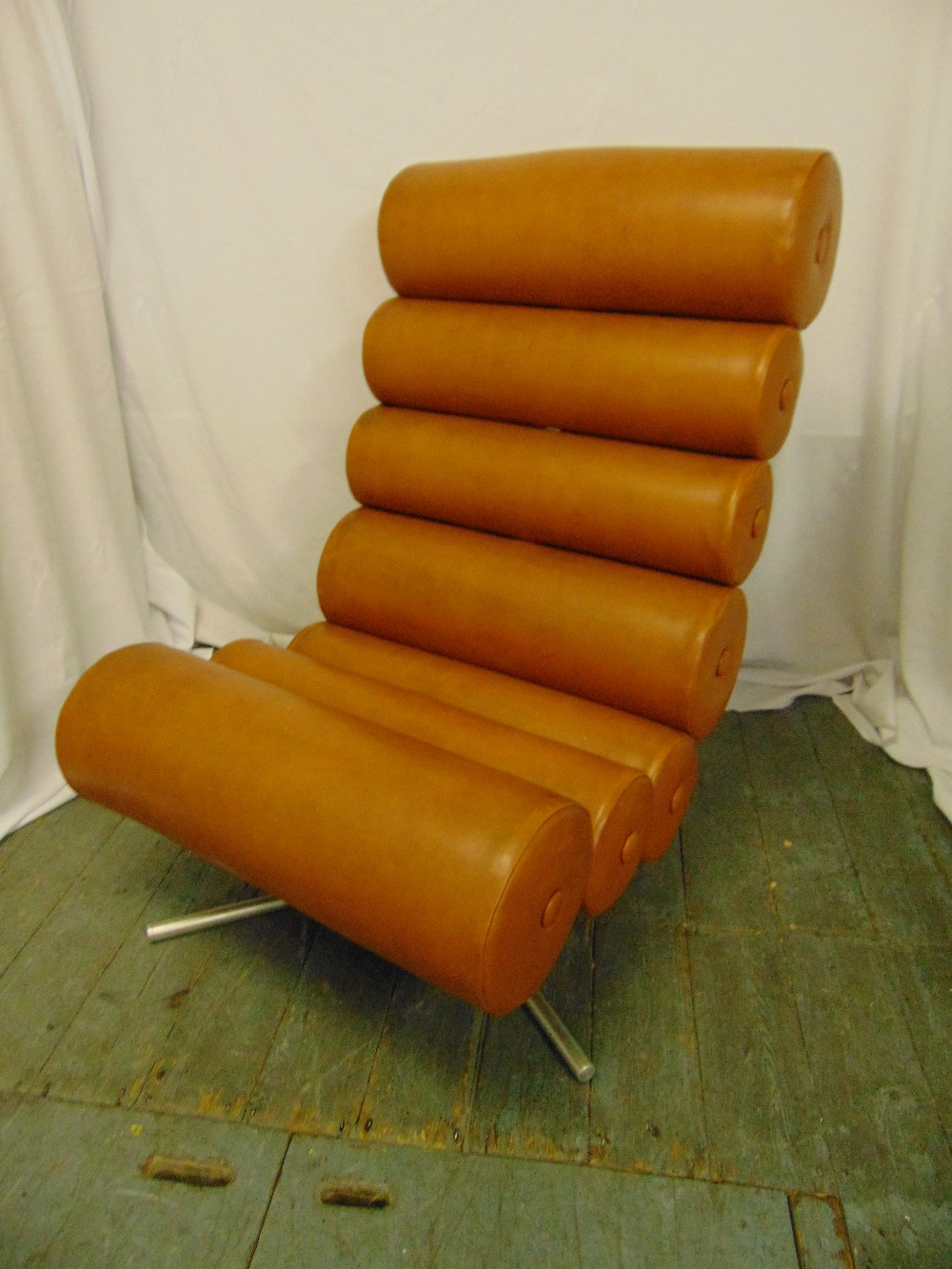 Lot 8 - A mid 20th century brown faux leather (sausage) chair of tubular sections on triform metal base