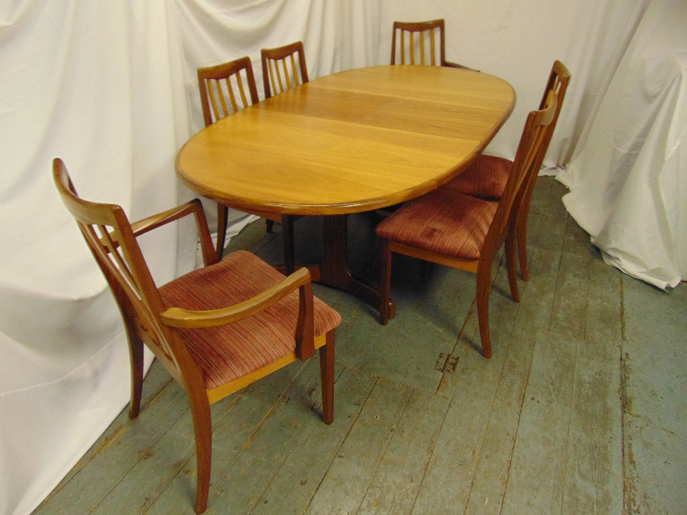 Lot 1 - G-Plan teak oval dining table circa 1980 and six matching chairs, 72 x 107 x 209