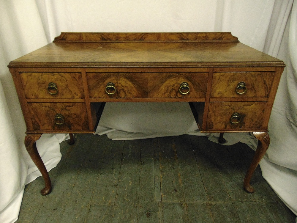 Lot 4 - A late Victorian walnut rectangular dressing table with five drawers on cabriole legs