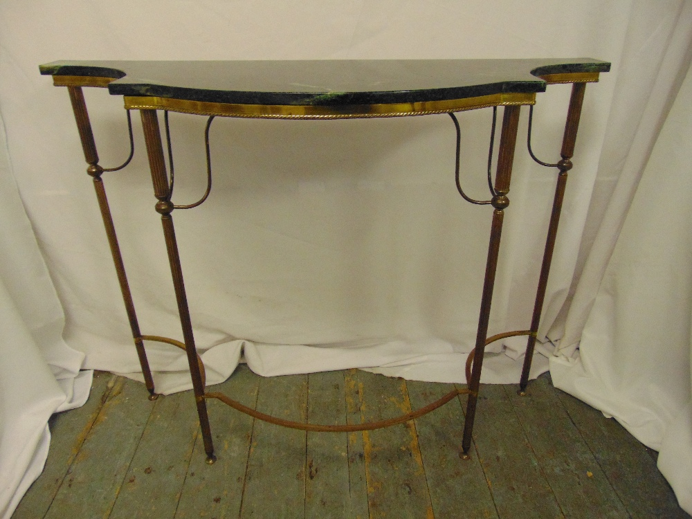 Lot 19 - A shaped rectangular gilded metal and marble consol table on four tapering cylindrical legs, 84.5