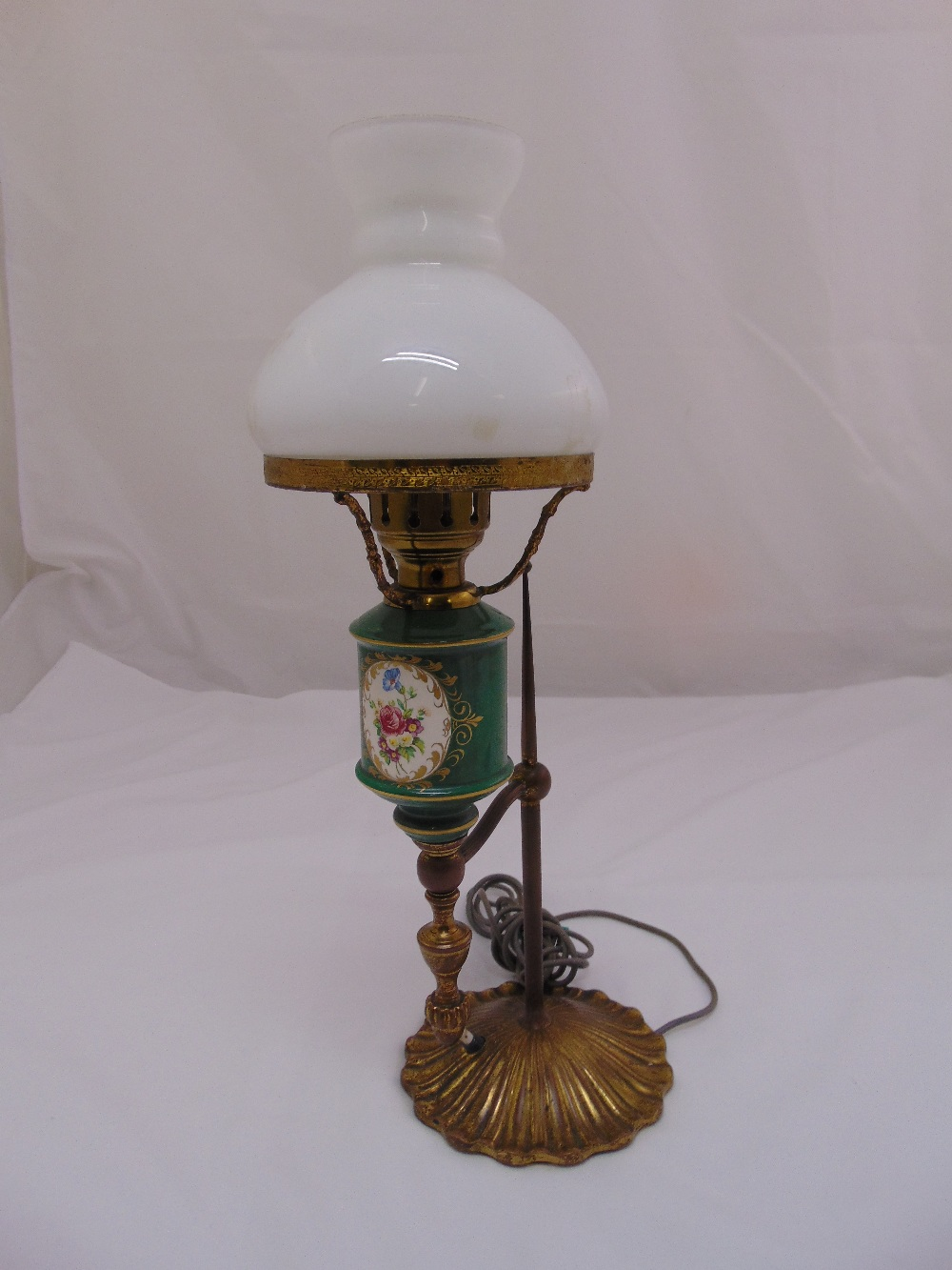 Lot 29 - A porcelain and brass table lamp with detachable glass dome