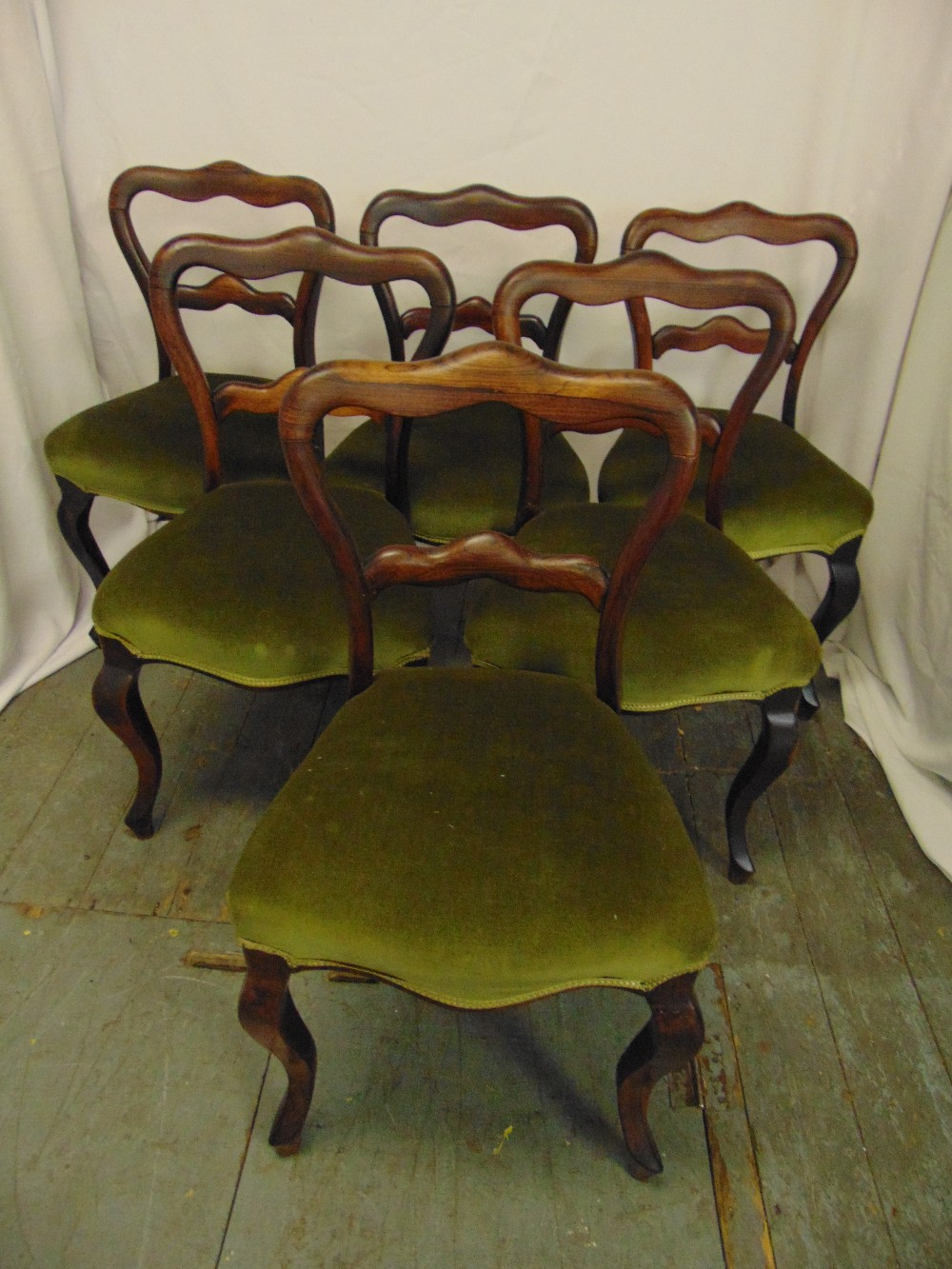 Lot 10 - A set of six Victorian rosewood balloon back upholstered dining chairs on cabriole legs