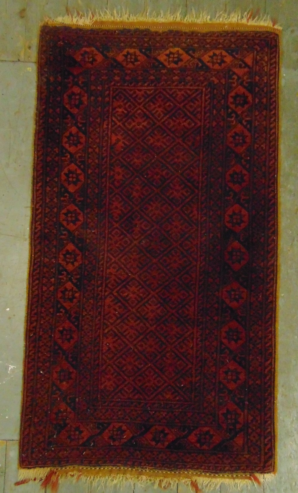Lot 22 - Two Persian rugs, red ground with repeating motif patterns and borders A.140 x 80cm B.144 x 106cm