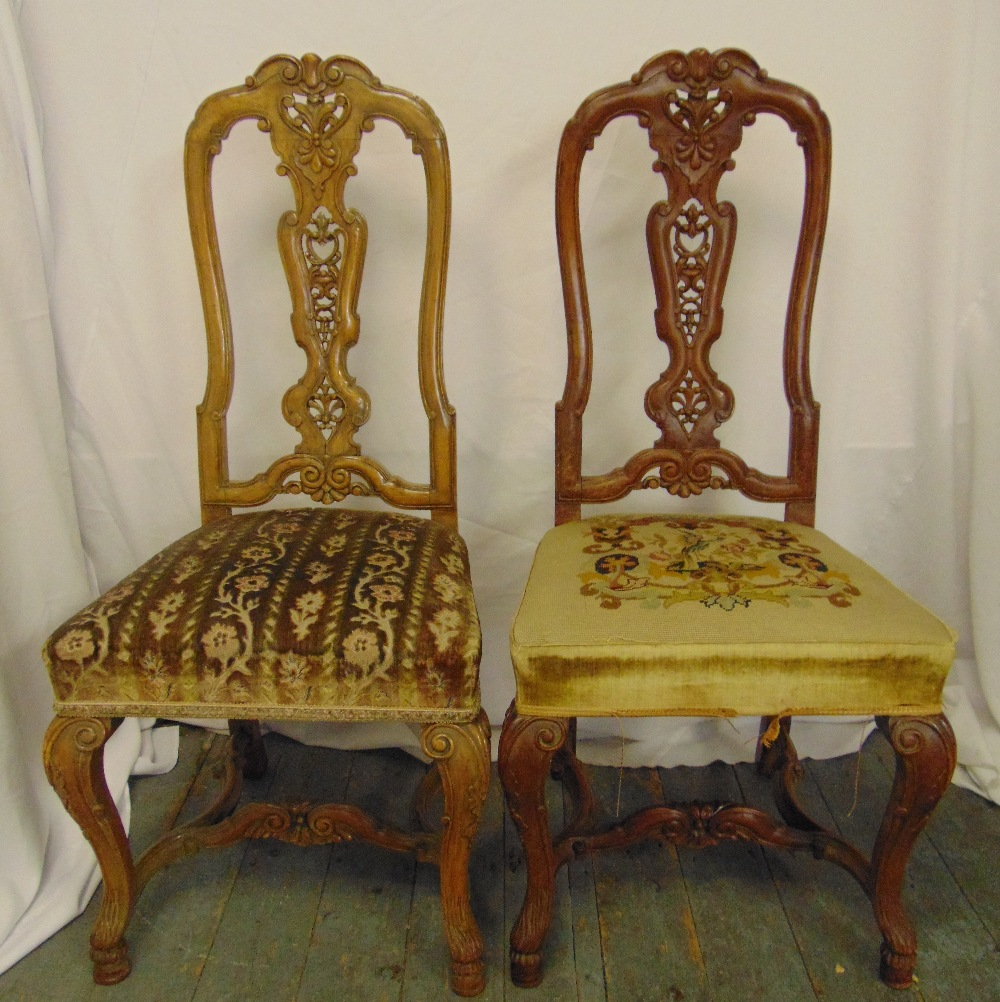 Lot 15 - A pair of continental mahogany hall chairs with upholstered seats and cabriole legs