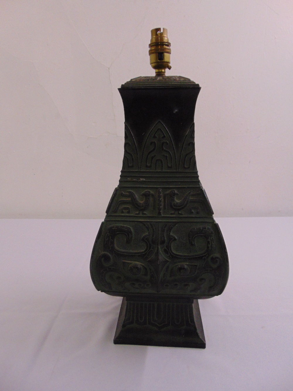 Lot 32 - A Chinese style shaped rectangular bronze table lamp