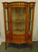 An Edwardian mahogany and satinwood glazed display case shaped rectangular with bow front, decorated