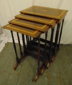 A mahogany and kingswood nest of four rectangular tables on turned cylindrical supports and scroll