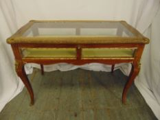 A Louis XVI style rectangular mahogany and gilt metal bijouterie display table with glazed sides