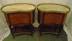 A pair of kidney shaped mahogany marble top side tables with pierced gilded metal galleries, the