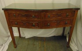 A rectangular mahogany canteen with lion mask handles, the four drawers revealing an extensive