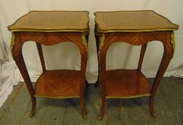 A pair of rectangular kingswood side tables with gilded metal mounts on four cabriole legs, 61.5 x