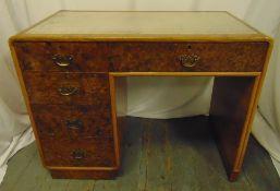 An Art Deco walnut veneered rectangular desk with one long drawer and three short drawers, 77 x 99 x