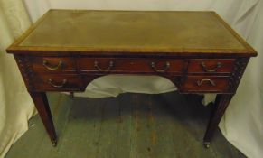 A Victorian rectangular leather top mahogany writing desk with five drawers, brass swing handles
